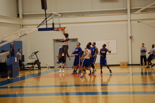 Josh Harrellson Watches as Amar'e Stoudemire Dunks in Practice.