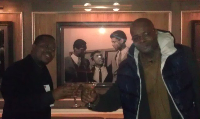 "Derrel ""Jazz"" Johnson and Cedric Leake in front of Iconic Photo at 40/40 Club"